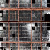 Old building wall with dirty broken windows glass Stock Images