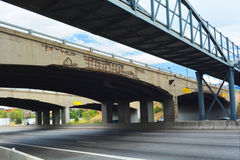 Old Cracked Concrete Highway Overpass. Crumbling infrastructure on a highway overpass exposes rebar Stock Photos