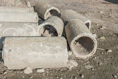 Old and cracked concrete pipe for watering. Stock Image