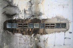 Old cracked concrete wall vent Stock Images