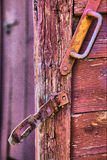 Old cracked country door surface with iron bolt catch lock and d Royalty Free Stock Photography