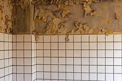 Old cracked dilapidated wall and ceramic tiles Royalty Free Stock Photography