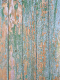 Old cracked faded cyan fence. Of a village in Ukraine, a sign of poverty and abandonment Royalty Free Stock Photos