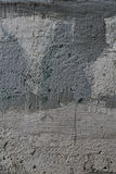 Old cracked gloomy concrete wall Stock Image