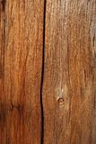 Old cracked grainy wood. Of dark warm color royalty free stock images
