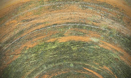 Old cracked grindstone texture background. With rows Stock Images
