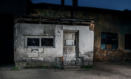 Old cracked or grungy house with brocken doors Royalty Free Stock Photos