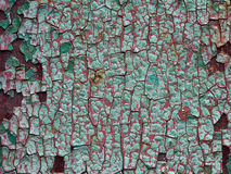 Old cracked pain. Texture of the old cracked paint on the rusty iron Royalty Free Stock Images