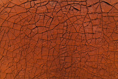Old cracked paint. Orange  background. Stock Image