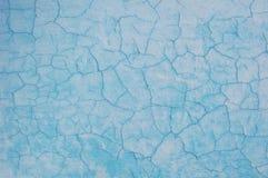 Old cracked paint pattern on concrete background. Peeling paint. Stock Image