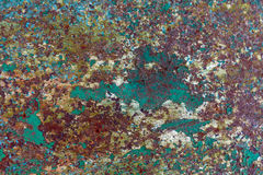 Old cracked paint pattern on rusty background. Royalty Free Stock Image