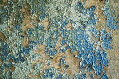 Old cracked paint. The wall covered with an old cracked blue and white paint Royalty Free Stock Photos