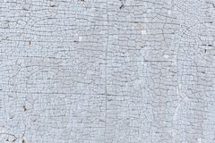 Old cracked paint on a wooden surface. Background Stock Photos