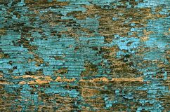 Old cracked paint on a wooden surface. As background Royalty Free Stock Image