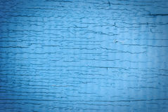Old cracked painted texture. Rusty blue wood. Stock Photos