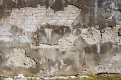 Old cracked plaster and brick wall royalty free stock photography