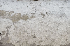 Old cracked plaster grunge textured background. Old cracked plaster on the cement wall. grunge textured background Royalty Free Stock Images
