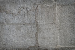Old cracked plaster grunge textured background. Old cracked plaster on the cement wall. grunge textured background Stock Photos