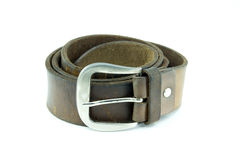 Old cracked rolled up brown leather belt Stock Photos