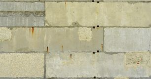 Old, cracked surface of concrete and bricks Stock Photo