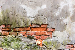 Old cracked wall. With a bummer and a break under Royalty Free Stock Photos