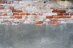 Old cracked wall with cement and bricks Stock Images