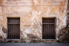 Old cracked wall. Old cracked street wall with some windows Stock Photography