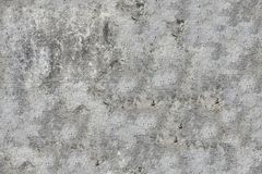Old cracked wall. Surface of old cracked gray granite wall background, seamless tiling Stock Image