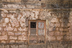 Old cracked wall with a window Royalty Free Stock Photography