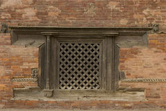 Old cracked wall with a window (Asian style) Royalty Free Stock Photos