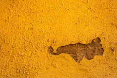 Old cracked wall. Old yellow with artistic cracked wall with a bummer Stock Photography