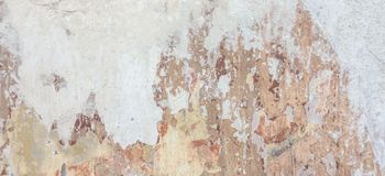 Old cracked weathered shabby plastered peeled wall banner background stock images