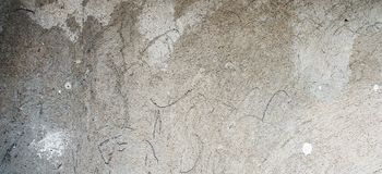 Old cracked weathered shabby plastered peeled wall banner background royalty free stock photos