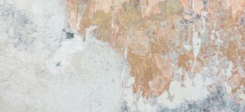 Old cracked weathered shabby plastered peeled wall banner background royalty free stock photography