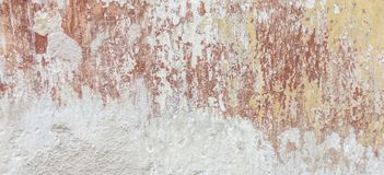 Old cracked weathered shabby plastered peeled wall banner background stock photos