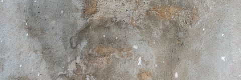 Old cracked weathered shabby plastered peeled wall banner background stock image