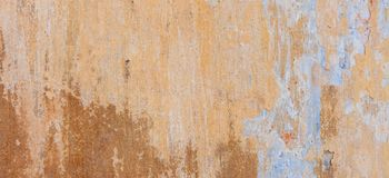 Old Cracked Weathered Shabby Plastered Peeled Wall Background. royalty free stock images