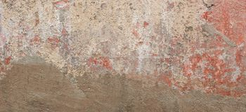 Old cracked weathered shabby red painted and new plastered wall banner background stock photos