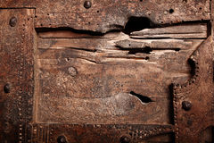 Old cracked weathered wooden handicraft Stock Photos