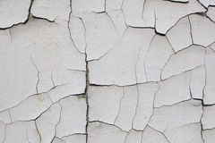 Old cracked white wall Stock Images