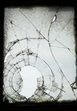 Old Cracked Window. A weathered, cracked and smashed window in an industrial warehouse Royalty Free Stock Photo