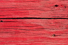 Old Cracked Red Wooden Boards. Old cracked wooden boards painted red - background texture Royalty Free Stock Photo