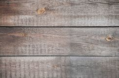 Old cracked wooden boards. Vertically nailed. Background. stock image