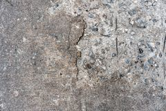 Old cracking road concrete floor texture that can see stone inside on the left side. Perfect for background.  royalty free stock photos