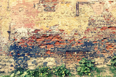 Old and cracky brick wall. Grunge background Stock Image