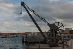Old crane in Copenhagen Harbor. In Denmark Royalty Free Stock Image