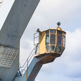 Old crane at the dock of the port Stock Photography