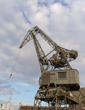 Old crane at harbour Stock Images