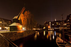 Old crane Ilmenau river at night Royalty Free Stock Photo