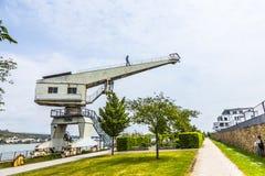 Old crane with iron man in Bingen, Stock Photo